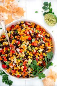 Multicolored Black Bean Corn Salsa Dip in a serving bowl.