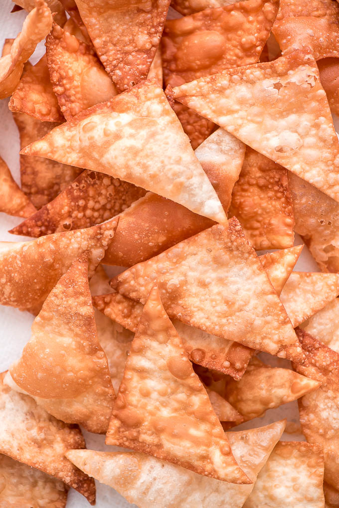Close up of a pile of fresh fried wonton chips