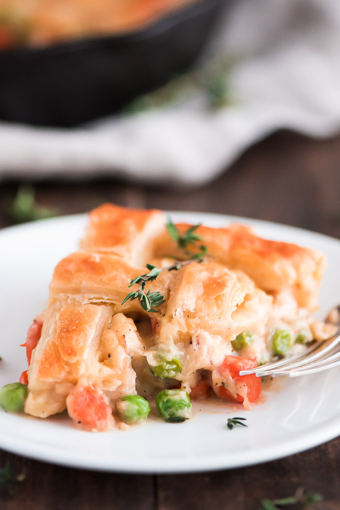 Slice of Easy Chicken Pot Pie with a golden puff pastry crust