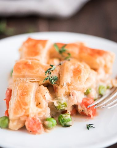 Close up slice of Easy Chicken Pot Pie with a golden puff pastry crust