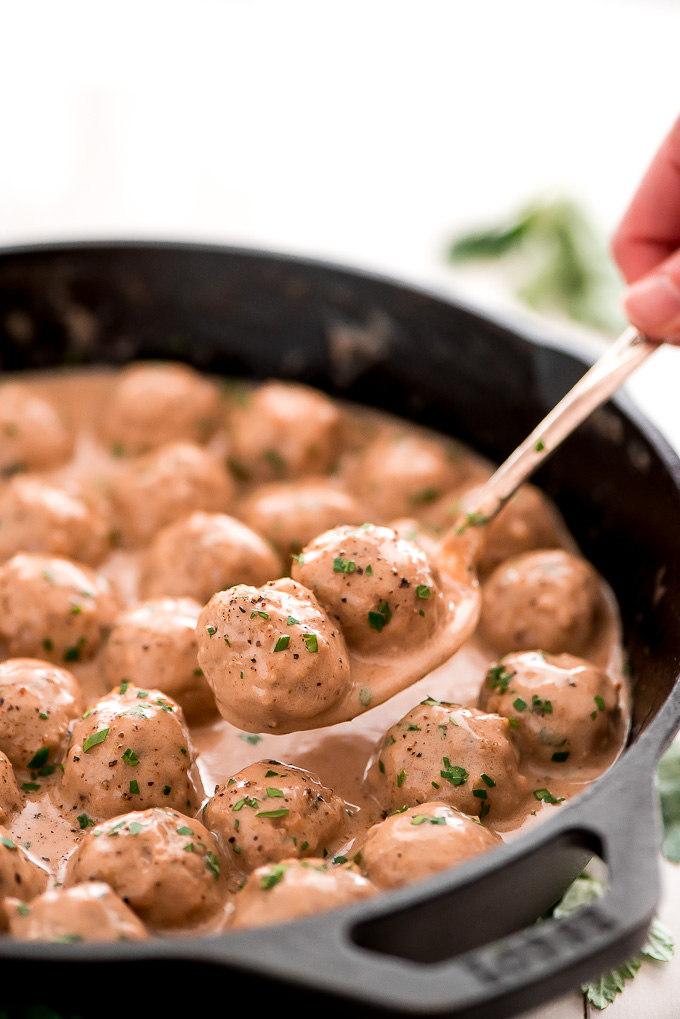 Close up of a spoonful of creamy Swedish Meatballs