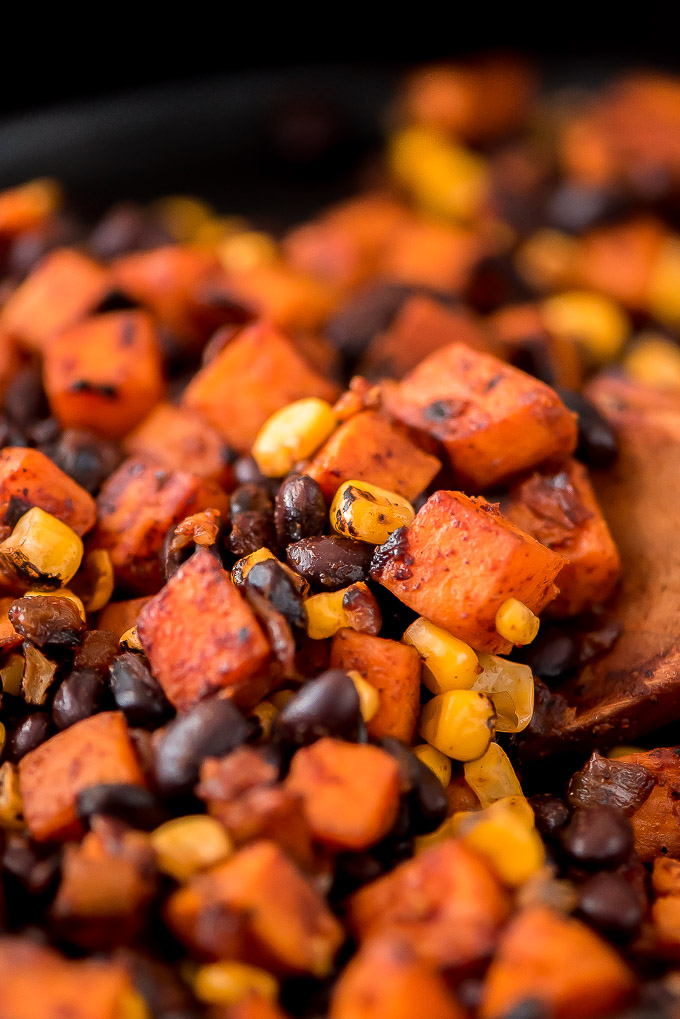 Black bean, sweet potato, and fire roasted corn filling for meatless enchiladas.