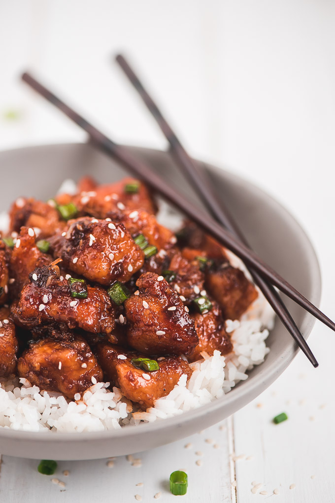 A bowl of Honey Garlic Chicken over a bed of white rice.