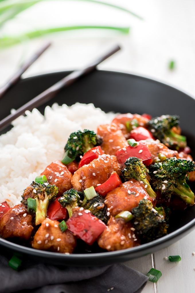 General Tso's Chicken in a bowl with white rice.