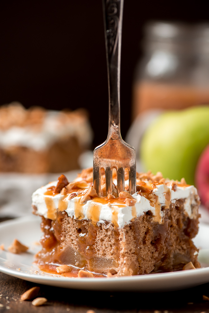 A piece of Caramel Apple Cake with a fork poking in it ready to take a bite.