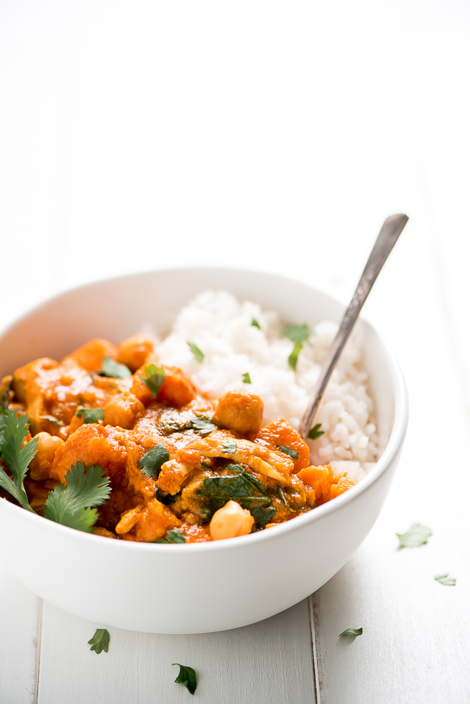 One bowl of Easy Instant Pot Chicken Curry and rice filled with chickpeas, spinach, and sweet potatoes.