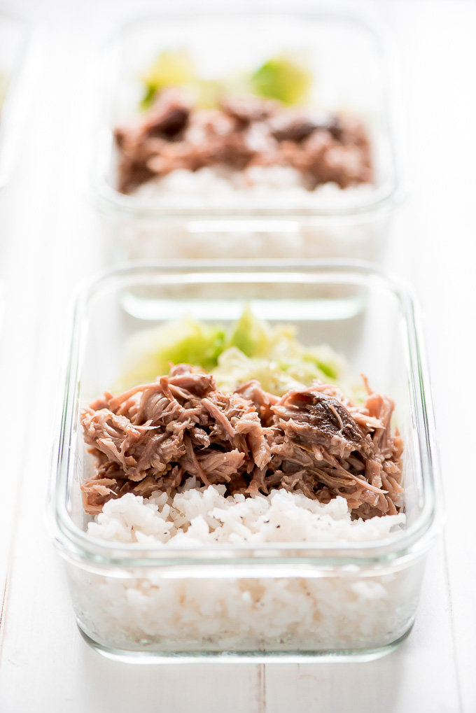 Meal Prep Instant Pot Kaula Pork in glass containers along with rice and cooked cabbage.
