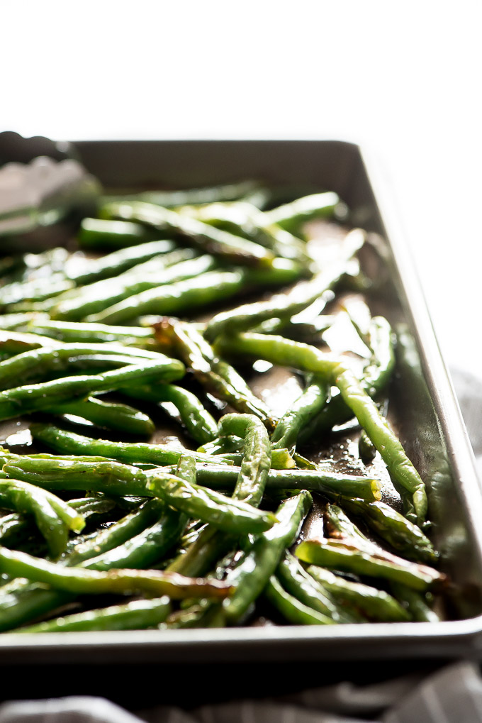 Close up of Roasted Green Beans on a baking sheet.