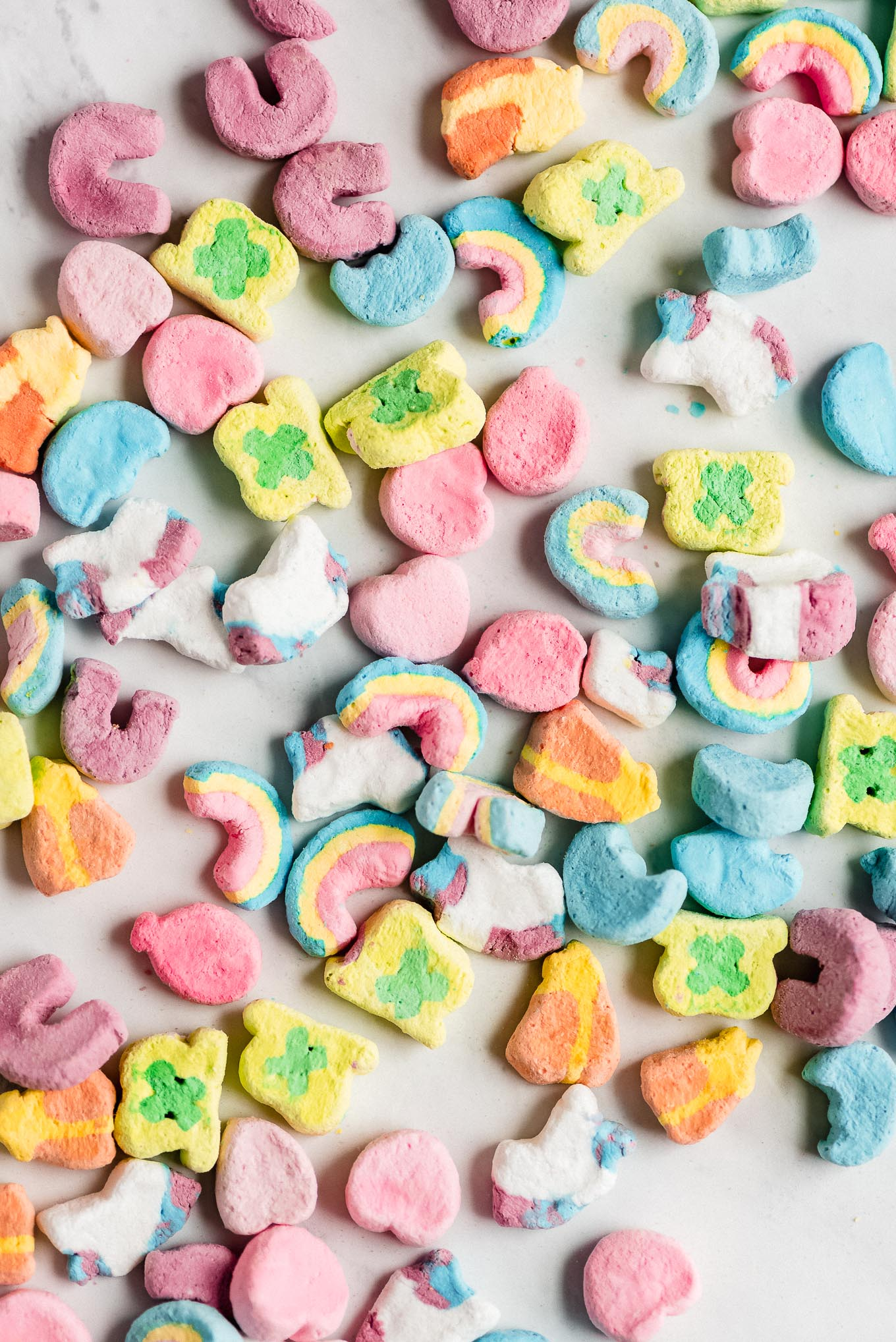 Lucky Charm marshmallows on a marble counter.