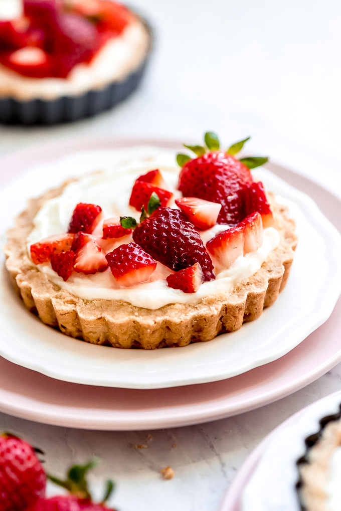 Close up of strawberries on top of a tartlet.