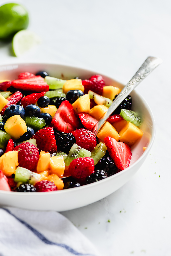 Close-up shot of a spoonful of Summer Fruit Salad.