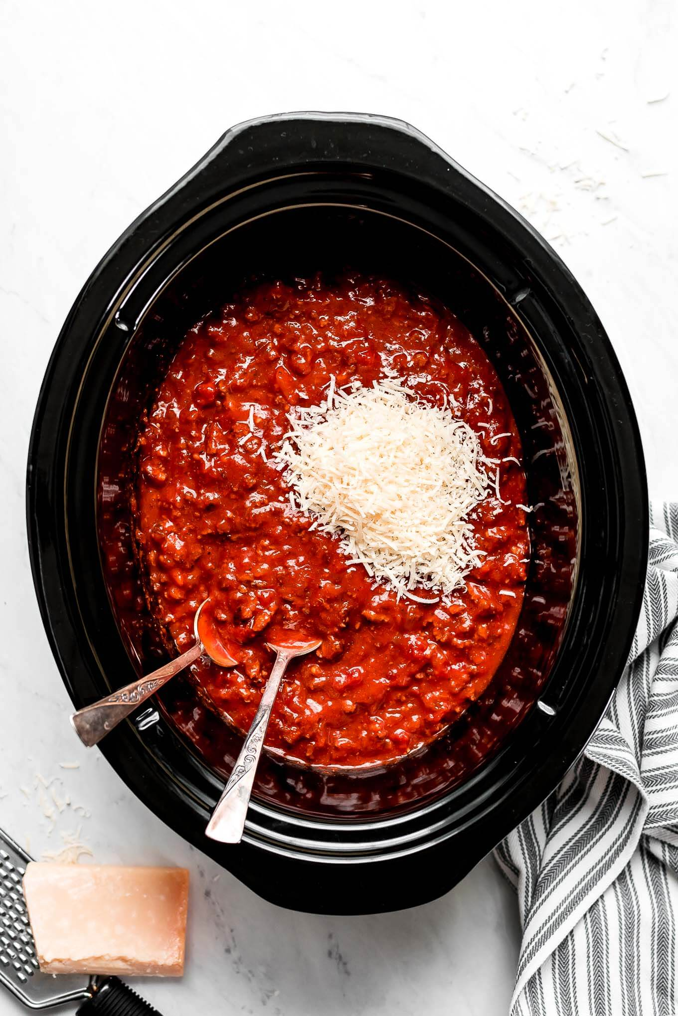 Slow Cooker Spaghetti Meat Sauce in a Crock-Pot with Parmesan cheese on top.