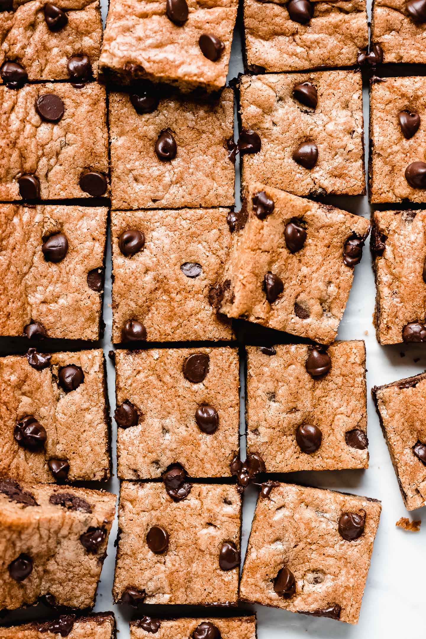 Toll House Chocolate Chip Bars cut into squares and studded with melty chocolate chips.