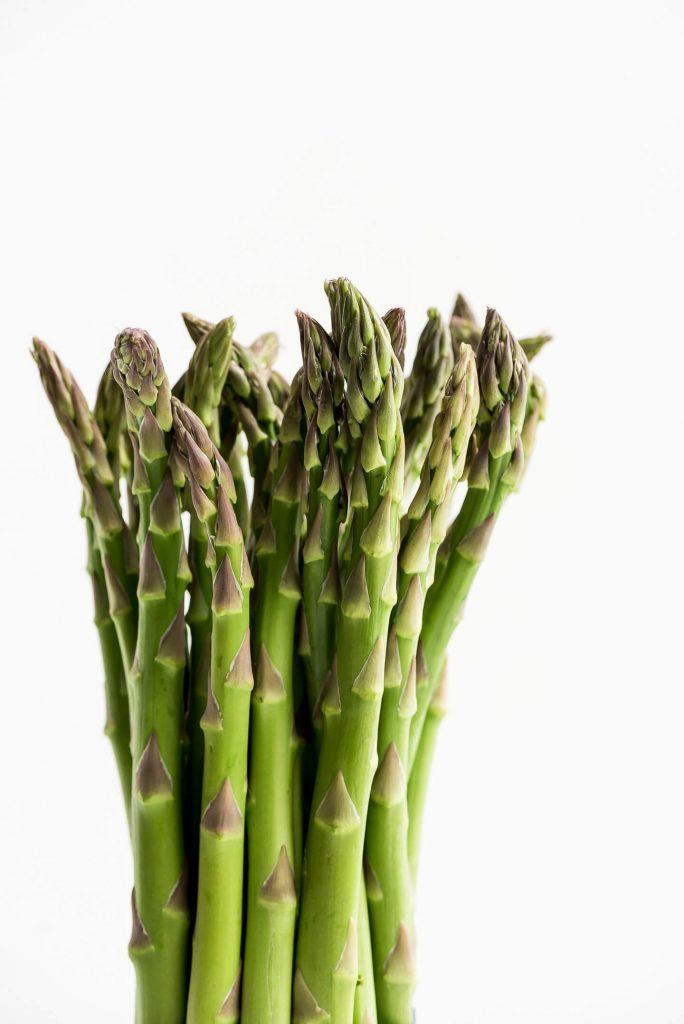 Fresh asparagus tips in a bundle.