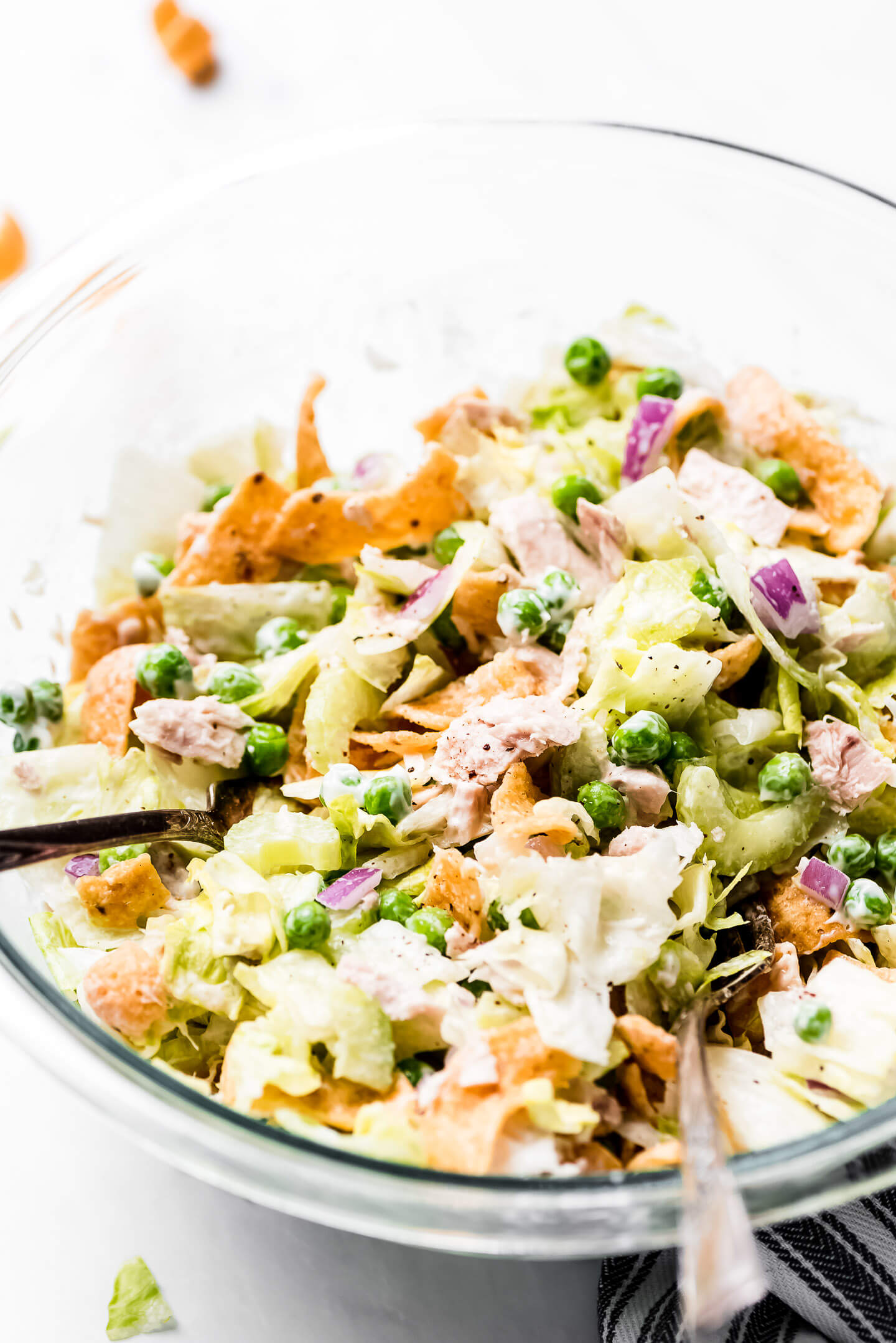 Chopped Salad with tuna, peas, red onions, lettuce, and Fritos.