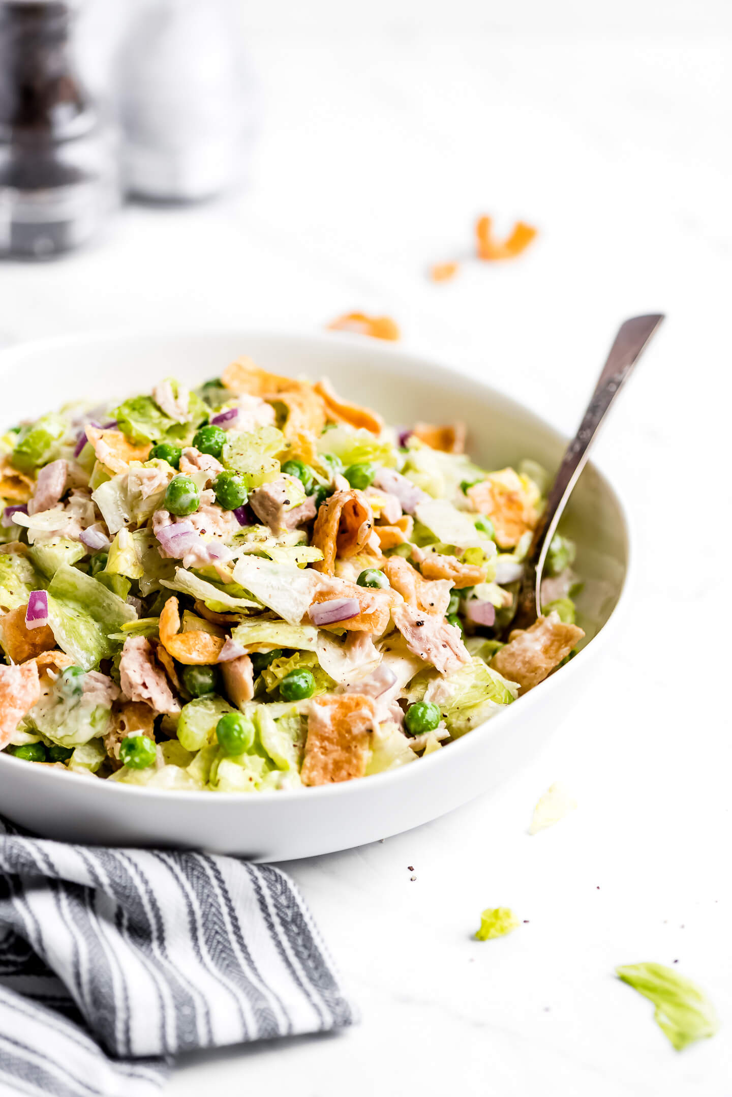 Tuna Salad in a large shallow bowl with a fork in the side.