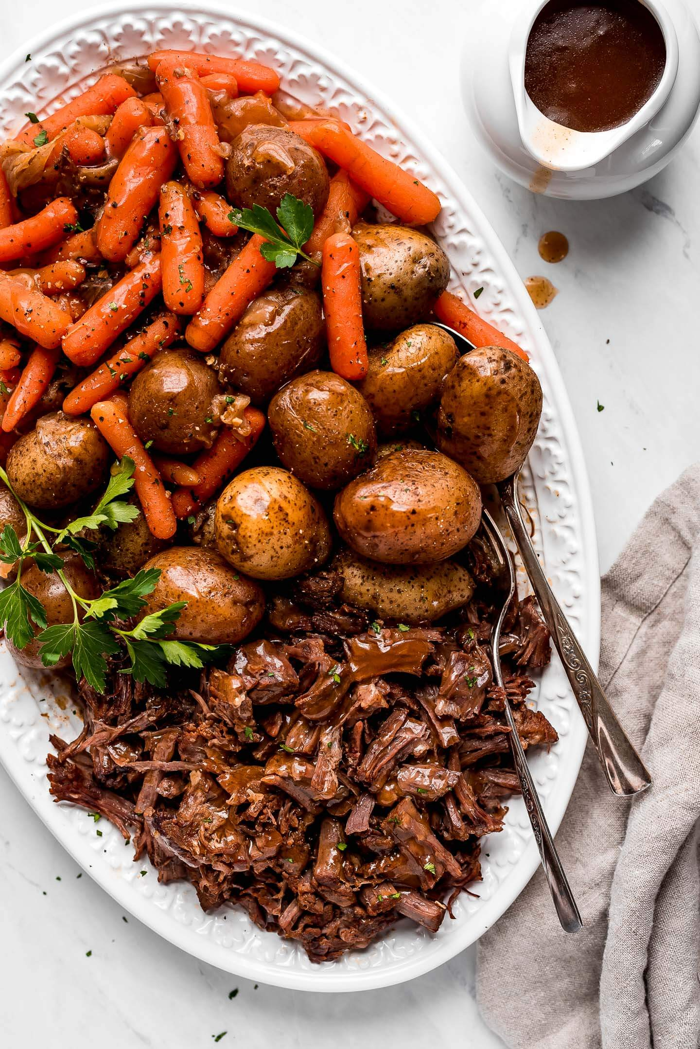 A large patter of Pressure Cooker Pot Roast, potatoes, and carrots.