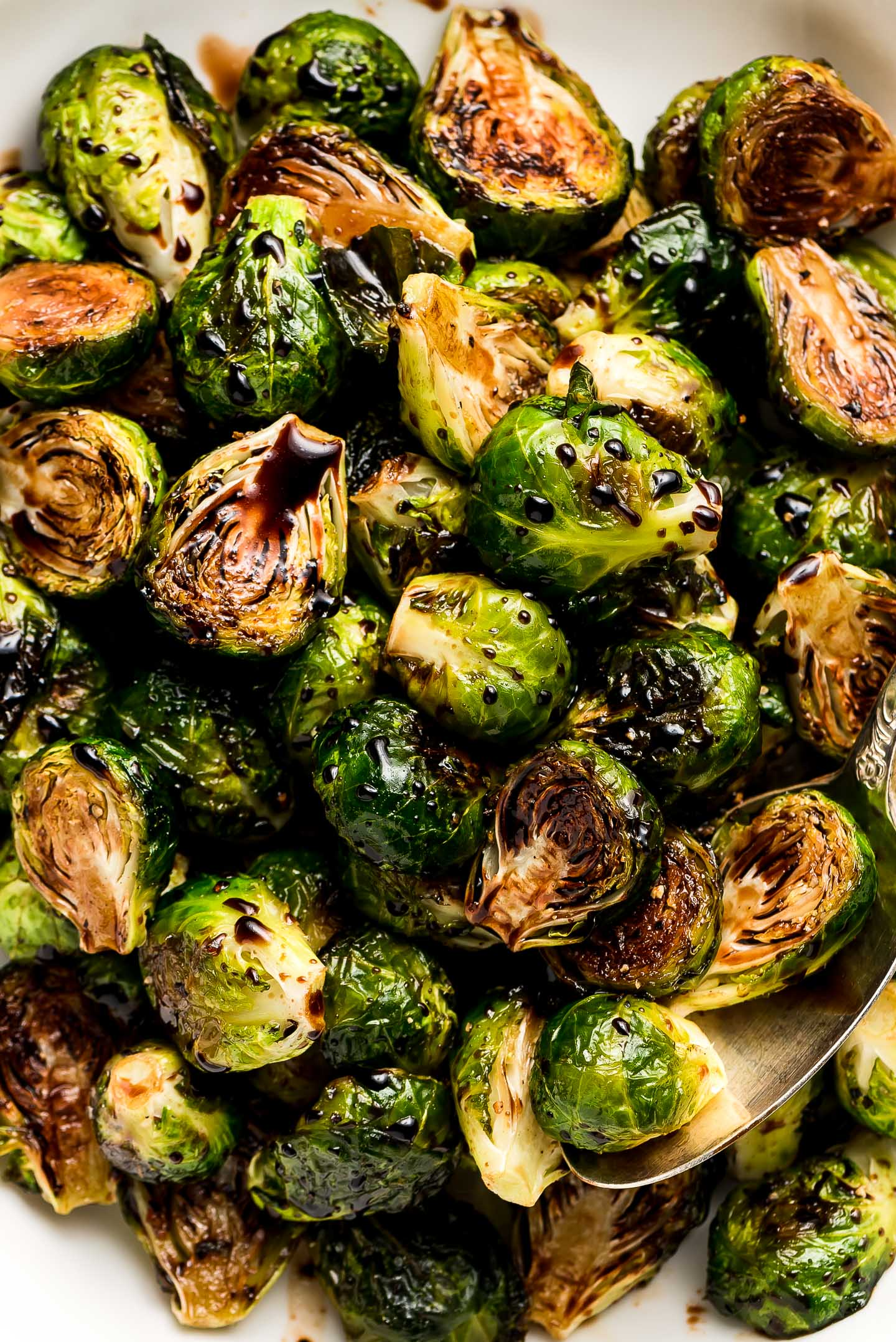 A close up of Roasted Brussel Sprouts with Balsamic Glaze.