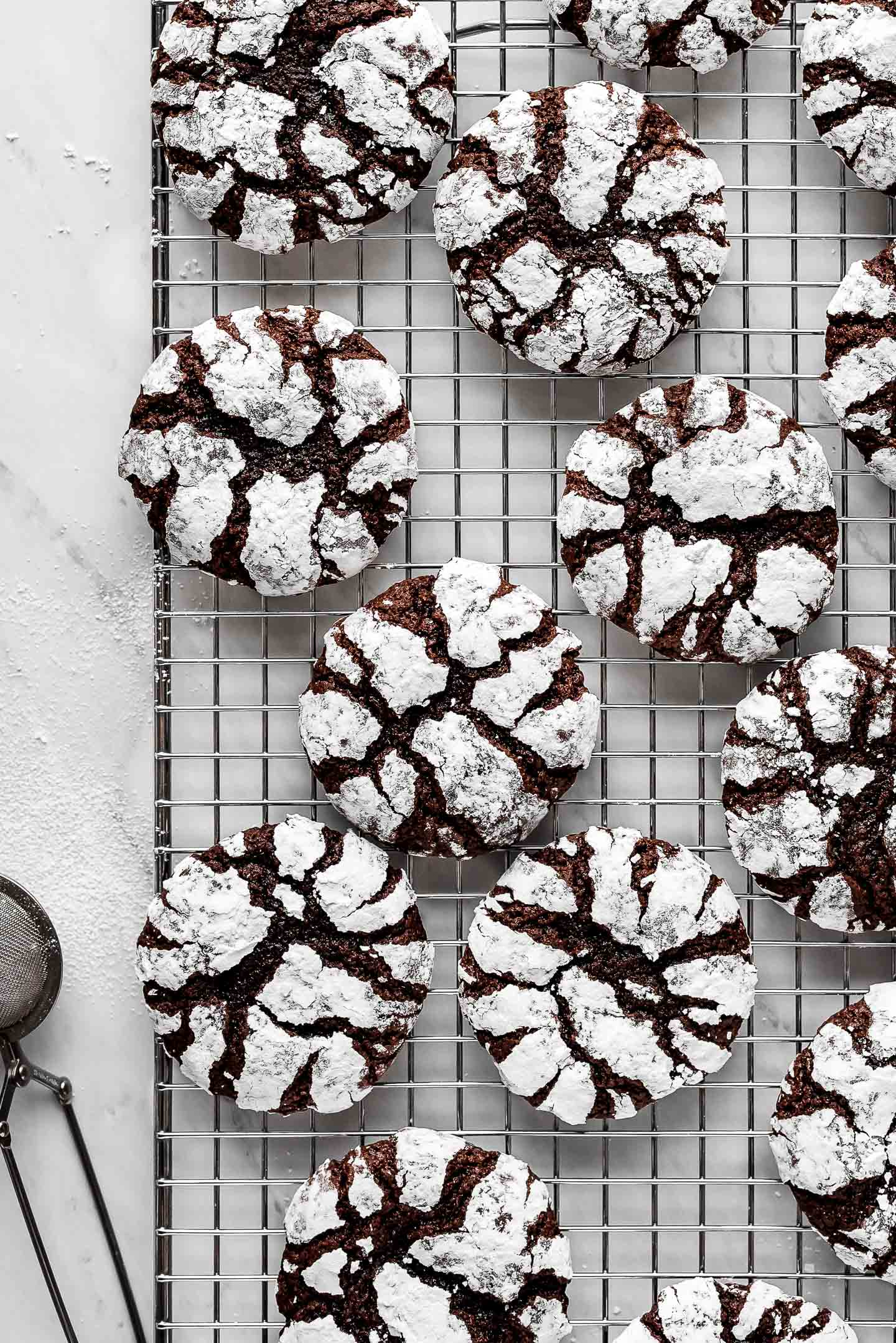 Chocolate Crinkle Cookies on a cooling rack.