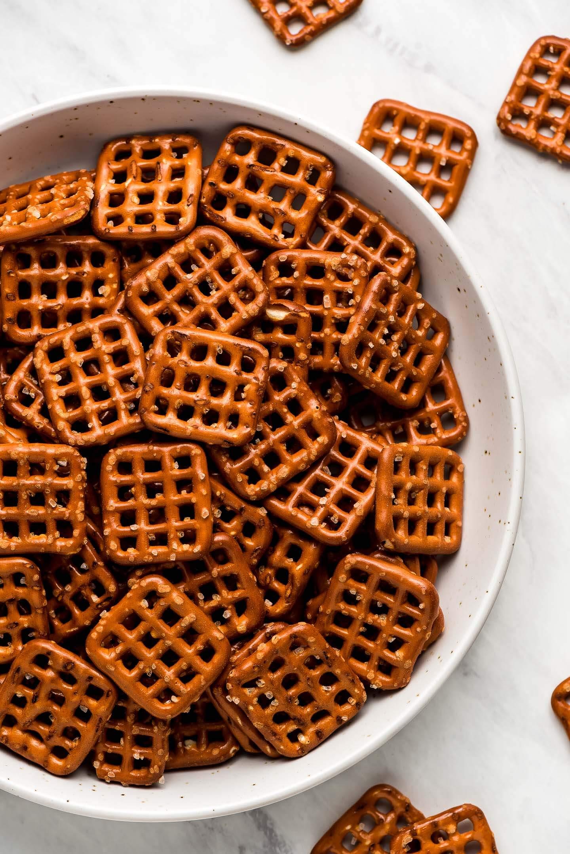 Square pretzel snaps in a bowl.