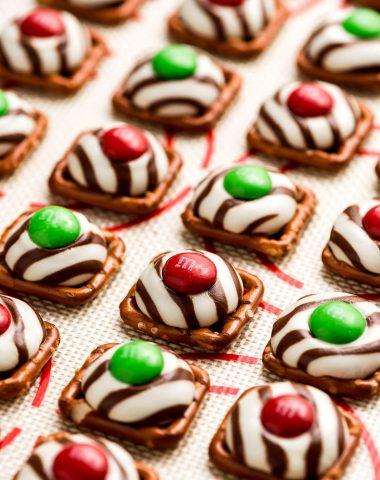 A close up of shot of a Christmas Pretzel Hug on a baking sheet.