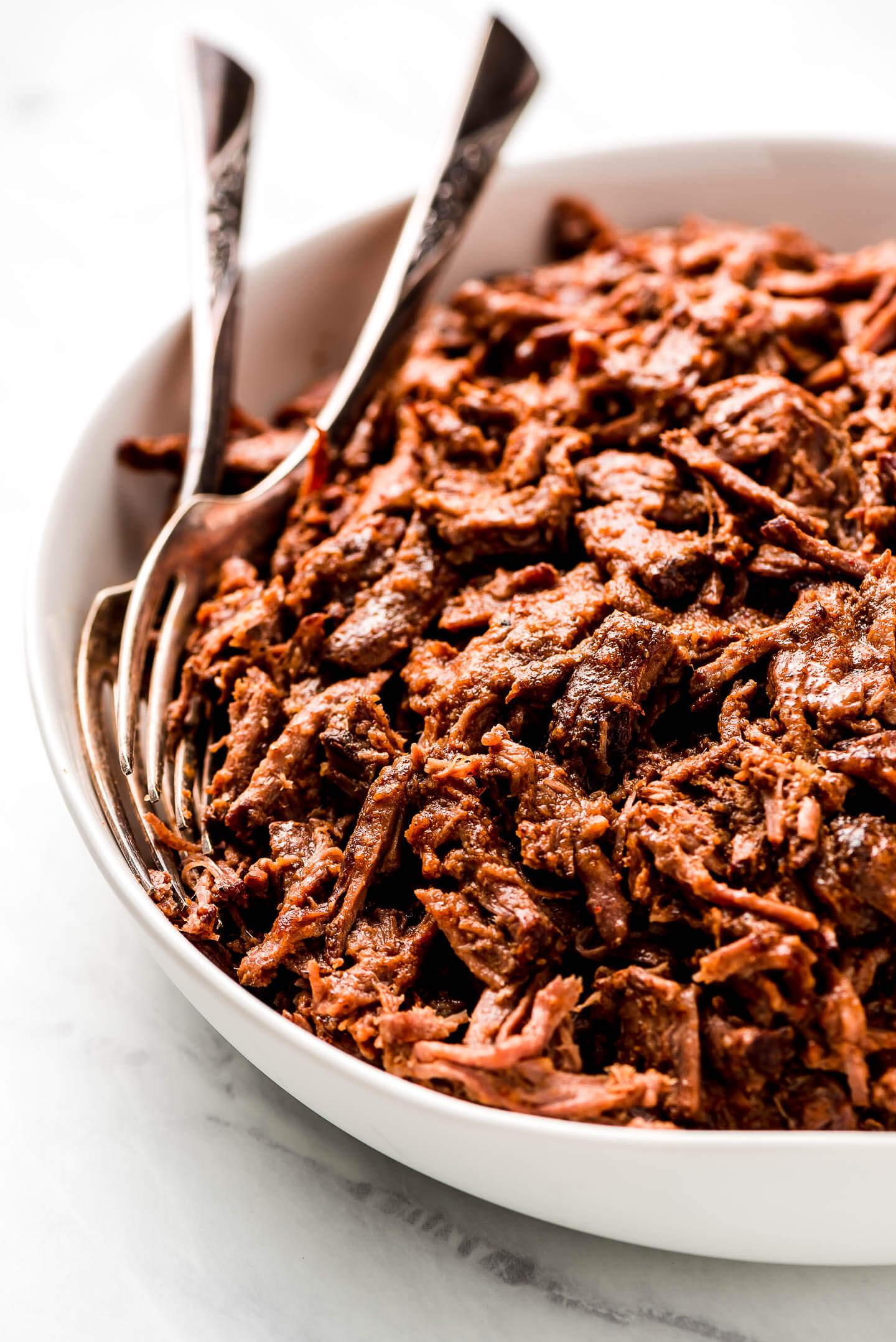 A large serving bowl of shredded Beef Barbacoa.