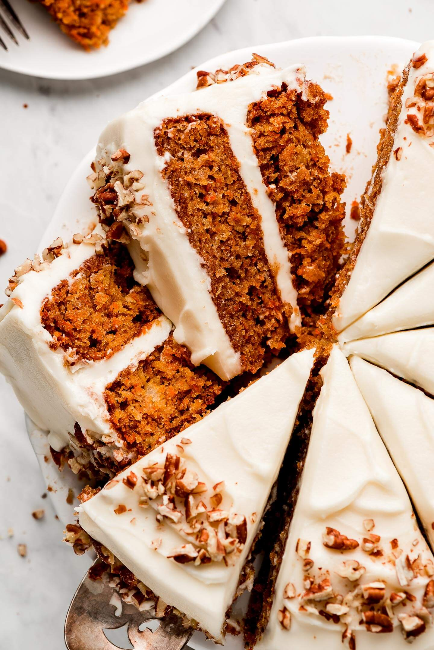 Slices of Moist Easy Carrot Cake on their side showing the layers and moist crumb.