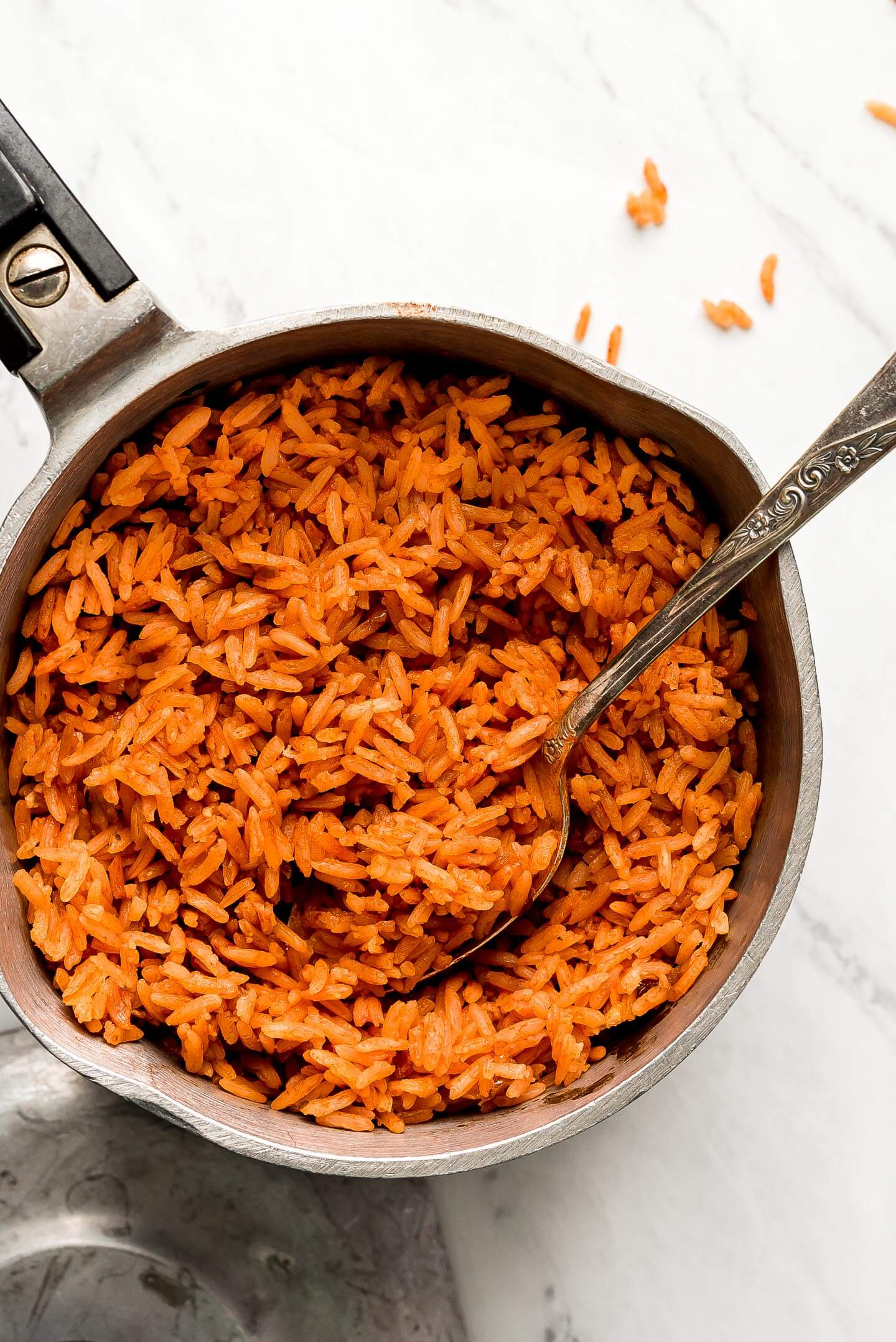 Red Spanish Rice in a pot with a spoon.
