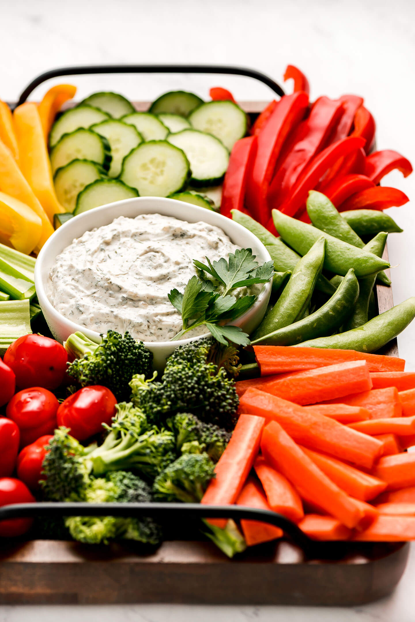 A platter of fresh vegetables and a bowl of Veggie Dip.