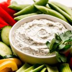 A close up shot of a bowl of Vegetable Dip.