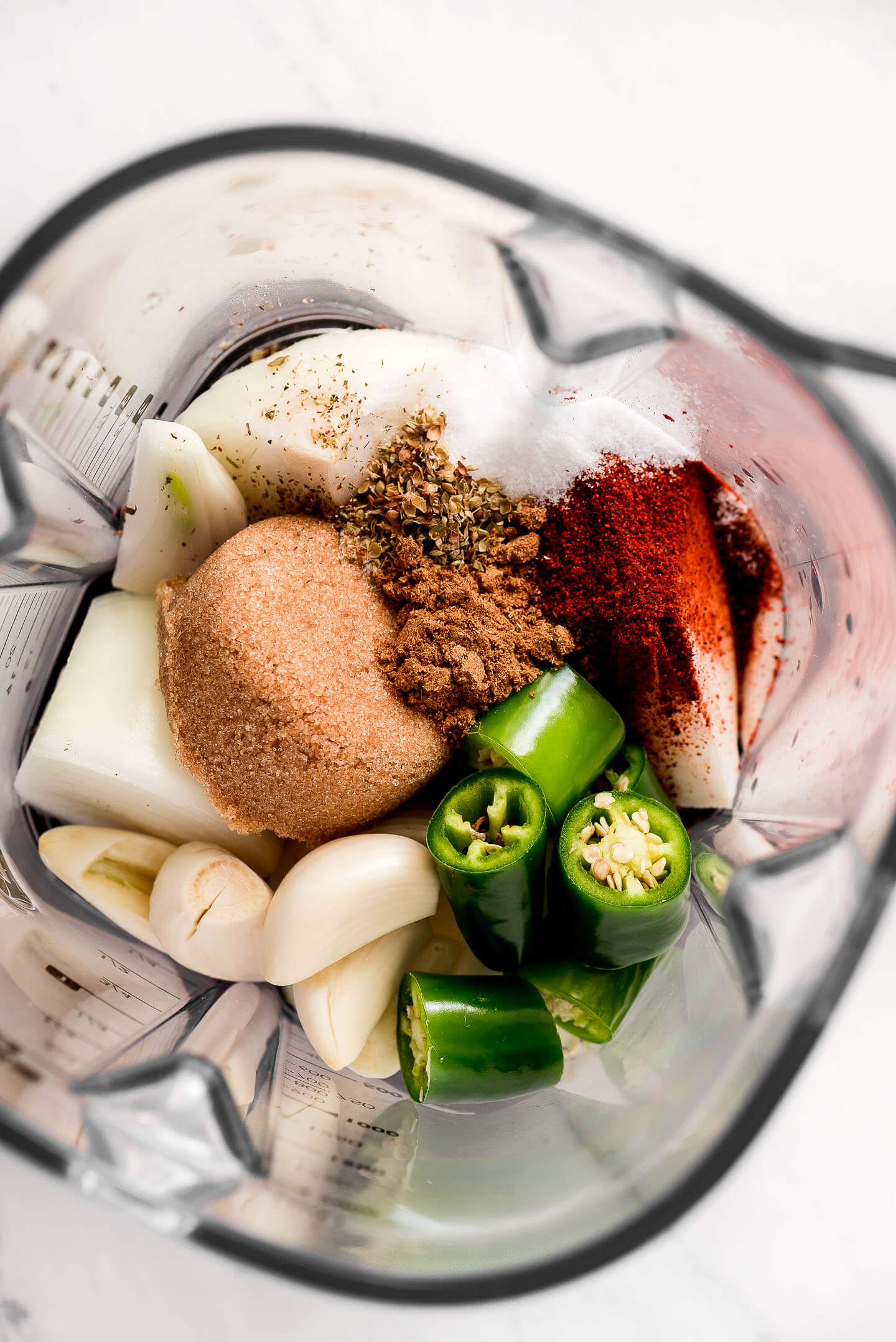 A blender of onion, garlic, jalapeno, brown sugar, spices, and dried herbs,