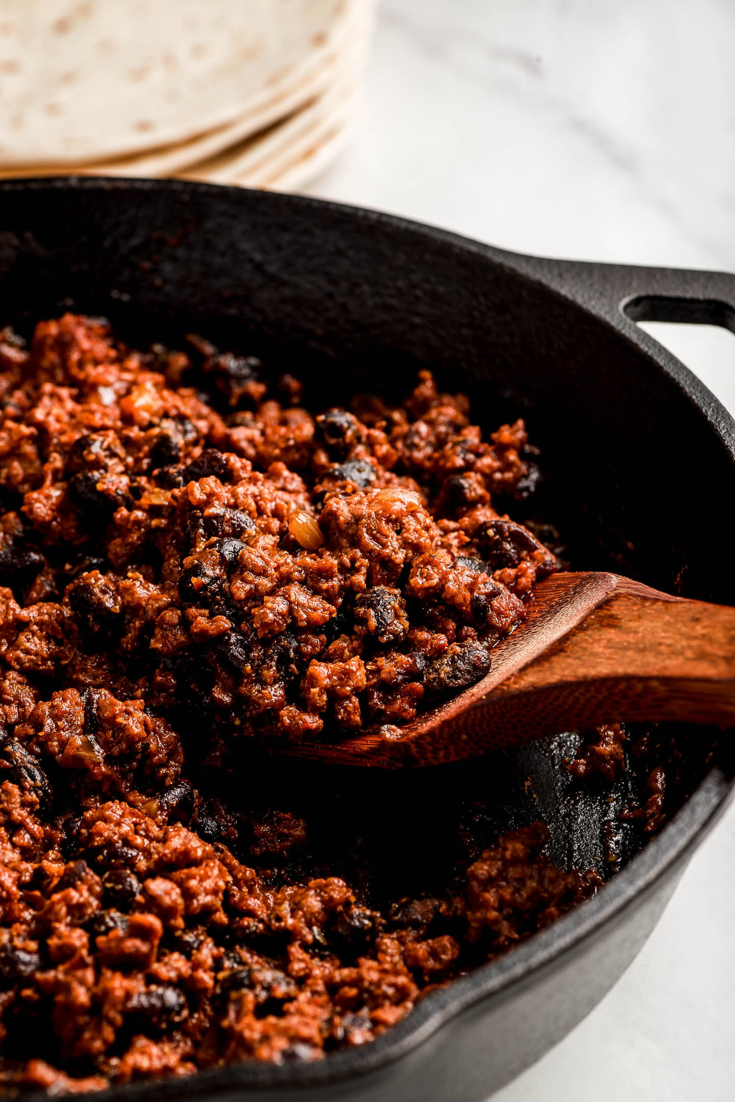 Close up shot of Ground Beef Taco Meat in a cast iron skillet.