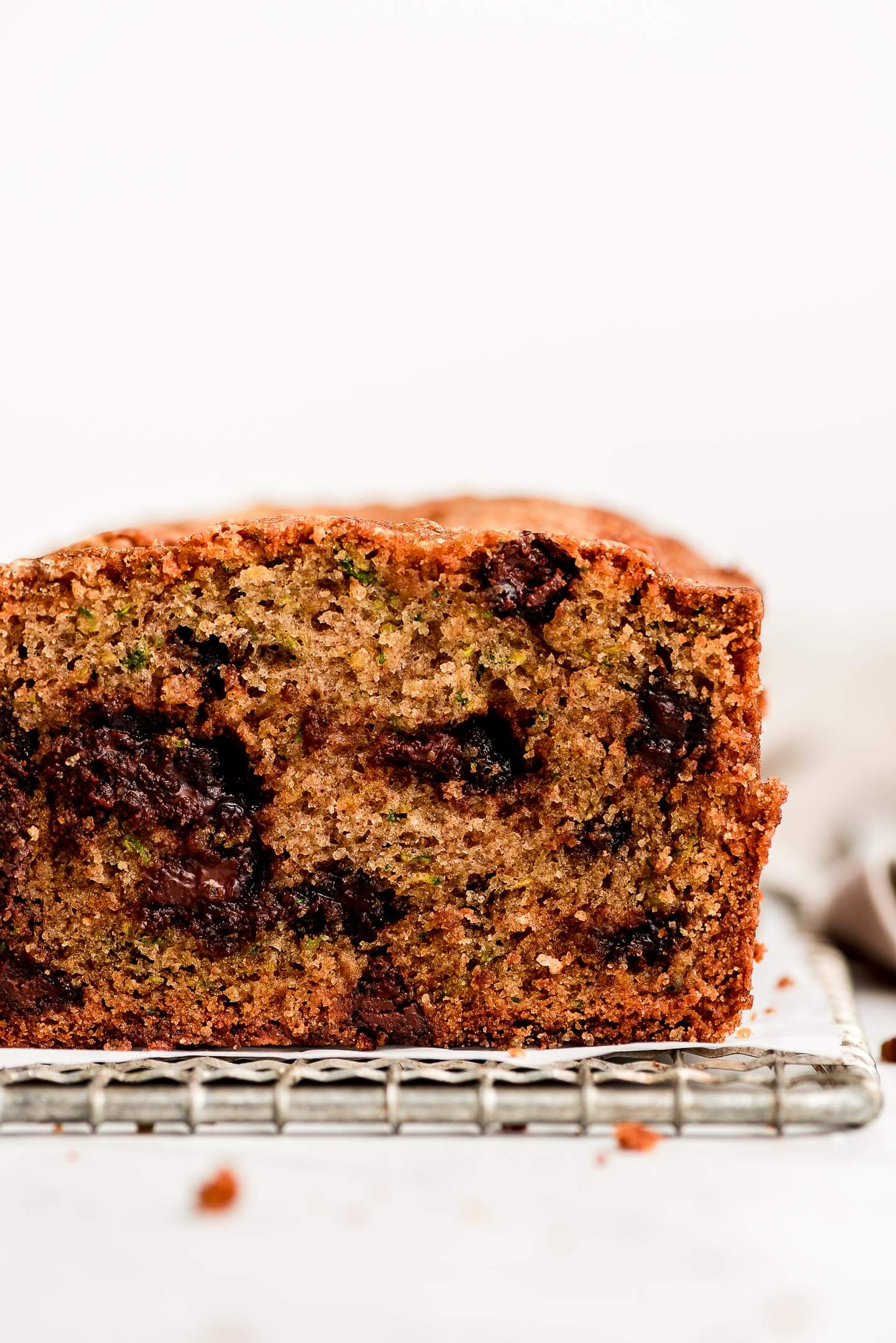 Cross section of zucchini bread studded with chocolate chips.