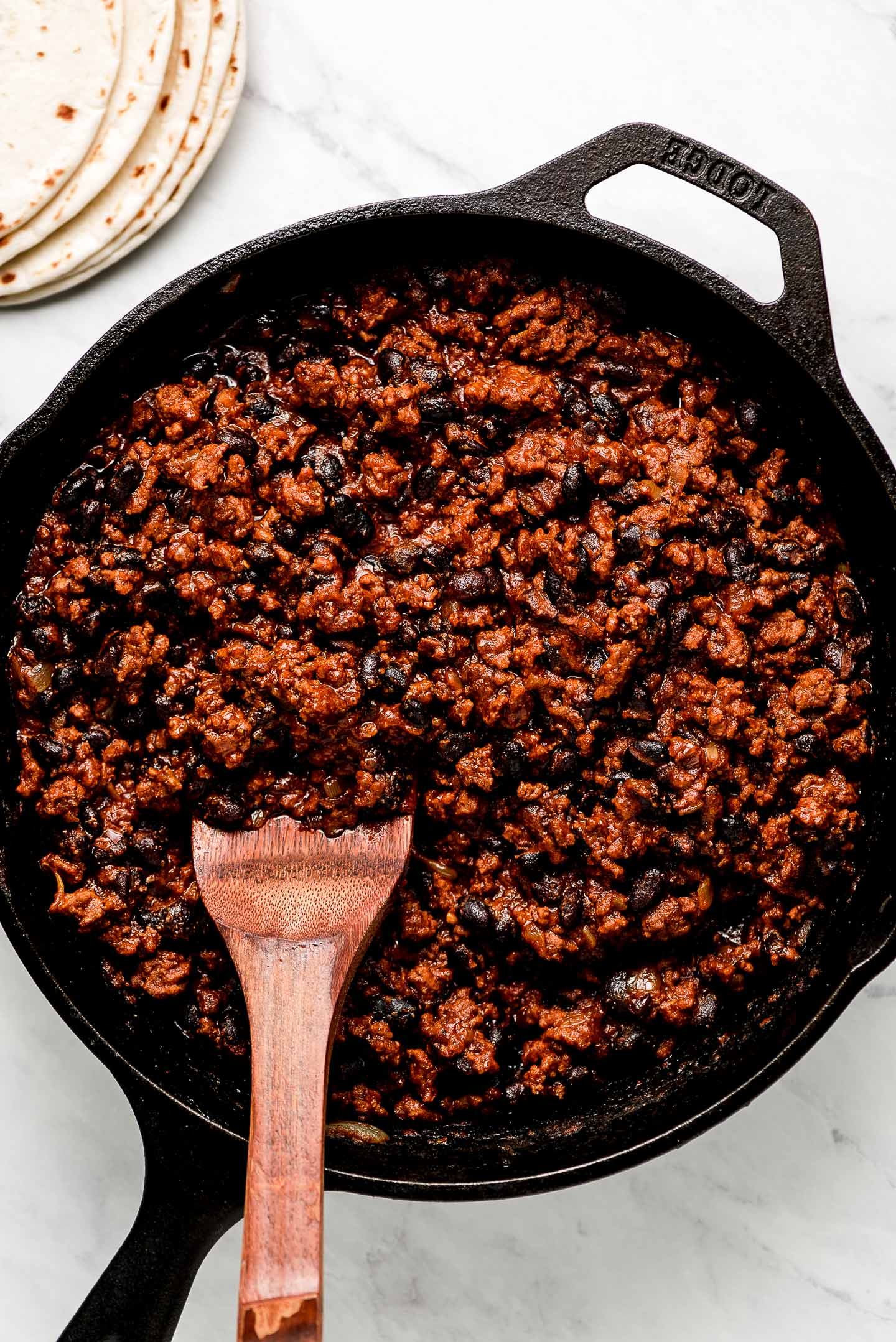 Ground Beef Taco Meat with black beans in a cast iron skillet.