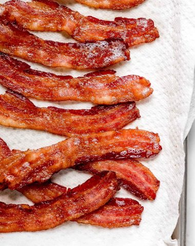 Strips of Oven Baked Bacon on a paper towel lined pan.